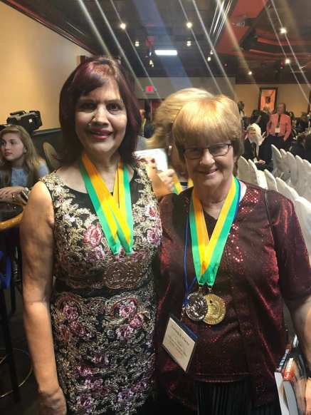 BRENDA AND I WITH MEDALS 2018